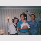 John holding daughter Rebekah with Mum and Dad